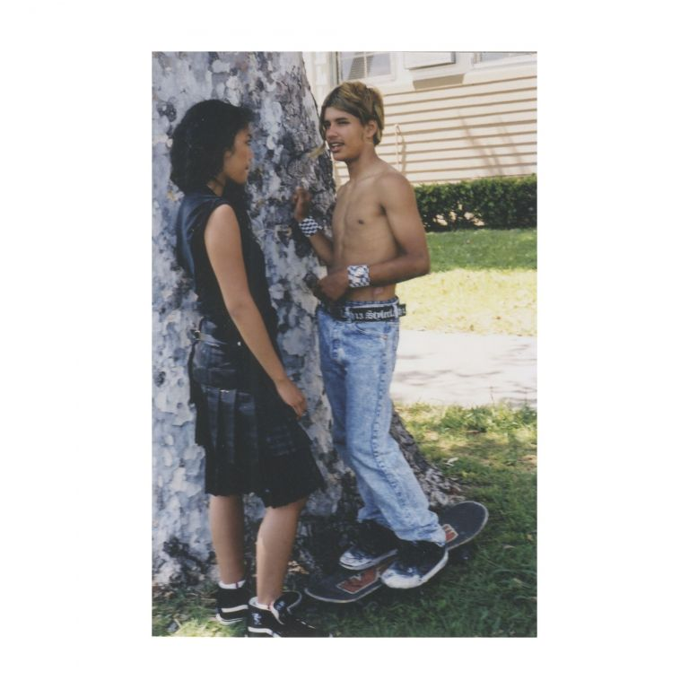 Untitled (Girl and Boy Talking by Tree). Larry Clark.
