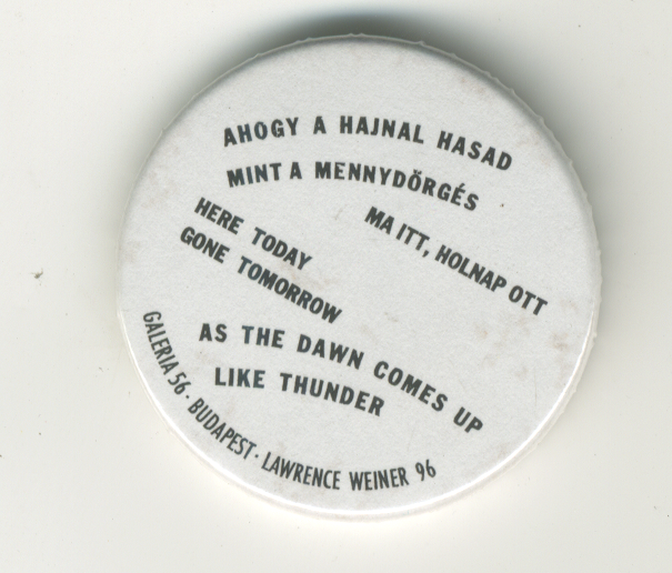 As The Dawn Comes Up Like Thunder button. Lawrence Weiner.
